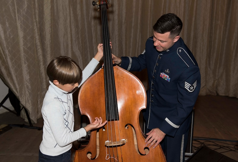 "U.S. Air Force Staff Sgt. Benjamin Thomas, U.S. Air Forces in Europe Ambassadors Jazz Band bass player, talks with a local music student about needing to grow a little before being able to play the bass, during a master class with the USAFE Band and the Ukrainian National Presidential Orchestra at the Philharmonic in Chernivisti, Ukraine, Oct. 12, 2019. The USAFE Band traveled to six cities in central and western Ukraine October 6-20, 2019 to conduct the ""Music of Freedom"" tour, which celebrated the shared spirit of freedom and enduring partnership between U.S. and Ukrainian armed forces. (U.S. Air Force photo by Airman 1st Class Jennifer Zima)"