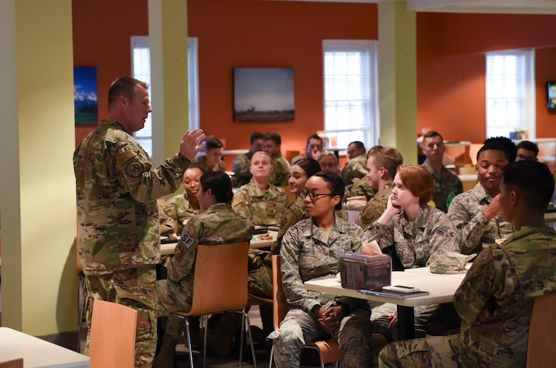 Chief Master Sgt. Charles Hoffman, Air Force Global Strike Command command chief, listens to the thoughts of Airmen during breakfast on Oct. 17, 2019, at F. E. Warren Air Force Base, Wyo. Hoffman visited many shops around base and took a look at some of the Airmen dormitories during his visit. (U. S. Air Force photo by Senior Airman Nicole Reed)
