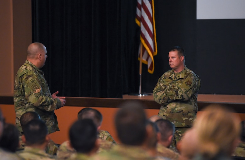 Chief Master Sgt. Charles Hoffman, Air Force Global Strike Command command chief, answers questions from Airmen during an all-call Oct. 17, 2019, at F. E. Warren Air Force Base, Wyo. Hoffman visited many Airmen over his multi-day visit and engaged in conversations with them about Air Force life and leadership. (U. S. Air Force photo by Senior Airman Nicole Reed)