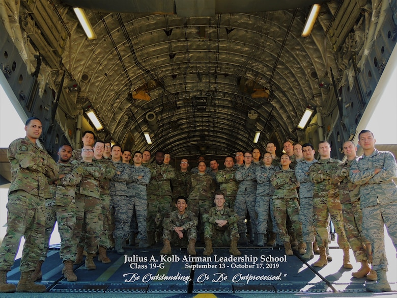 Graduates of ALS Class 19-G pose for a photo in the back of a C-17
