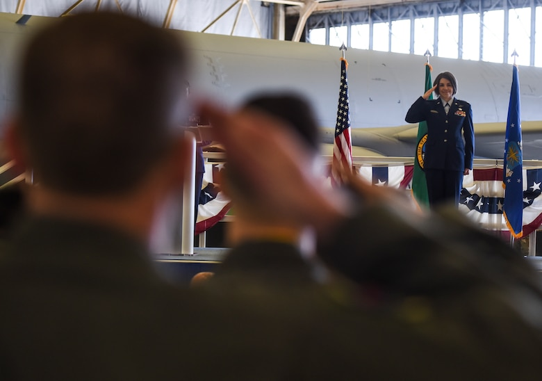 U.S. Air Force Lt. Col. Cindy Dawson, 97th Air Refueling Squadron commander, returns the squadron's first salute during the squadron's reactivation ceremony and Assumption of Command at Fairchild Air Force Base, Washington Oct. 18, 2019.