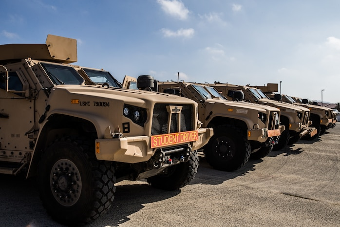 Joint Light Tactical Vehicles are staged prior to the I Marine Expeditionary Force JLTV Operator New Equipment Training course in 13 Area on Marine Corps Base Camp Pendleton, California, Oct. 17, 2019. The JLTV OPNET course is an eight day training evolution teaching students the vehicle's characteristics, operations, operator maintenance and safety.