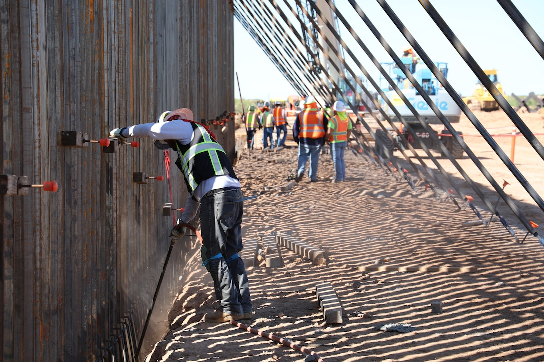 A U.S. Army Corps of Engineers Task Force Barrier contractor prepares the bottom of the steel bollard barrier panels for concrete placement near Columbus, N.M., Sept. 23, 2019. USACE is providing direction and oversight of Department of Defense (DoD)-funded construction of barrier system projects along the southwest border. These projects are being executed by USACE, as directed through the U.S. Army by the Secretary of Defense, in response to Department of Homeland Security's request for assistance to help secure the United States southern border by blocking drug-smuggling corridors through the construction of roads and fences, and the installation of lighting under the Title 10, section 284 of the U.S. Code. DoD and USACE are executing these projects in support of U.S. Customs and Border Protection.
