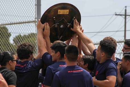 The Spartan Shield is presented to the poolees of Recruiting Sub-Station Escondido at Camp Pendleton, Calif., May 17, 2019. The 'Spartan Night' helps prepare poolees for what to expect while in boot camp and build comradery. The shield is presented to the strongest poolees.