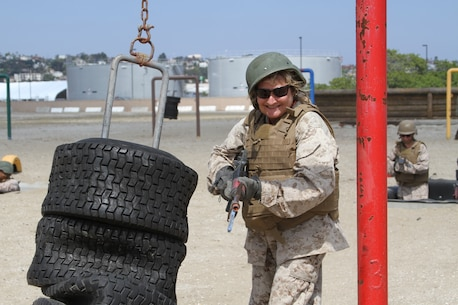 An educator from the San Diego area strikes a dummy on the bayonet assault course during the Educators' Workshop at Marine Corps Recruit Depot San Diego, June 17, 2019. The Educators' Workshop provides and in-depth experience about the transformation young men and women go through on their journey to claim the title Marine. (U.S. Marine Corps photo by Sgt. Bernadette Plouffe)