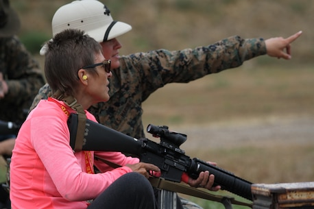 An educator from the San Diego area receives instructions from a U.S. Marine Combat Marksmanship Coach during the Educators' Workshop at Camp Pendleton, June 17, 2019. The Educators' Workshop provides and in-depth experience about the transformation young men and women go through on their journey to claim the title Marine. (U.S. Marine Corps photo by Sgt. Bernadette Plouffe)