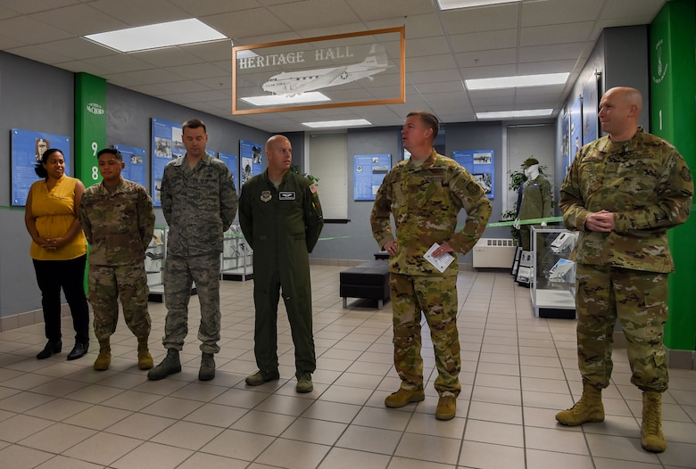 Col. Scovill Currin, 62nd Airlift Wing commander, recognizes a team of McChord Airmen and civilians who worked to update the Heritage Hall in the wing headquarters building at Joint Base Lewis-McChord, Wash., Oct. 21, 2019. The new heritage hall features photos and information highlighting McChord's involvement in historical operations while also showcasing what the men and women serving today are doing to complete the Air Force mission. (U.S. Air Force photo by Senior Airman Tryphena Mayhugh)