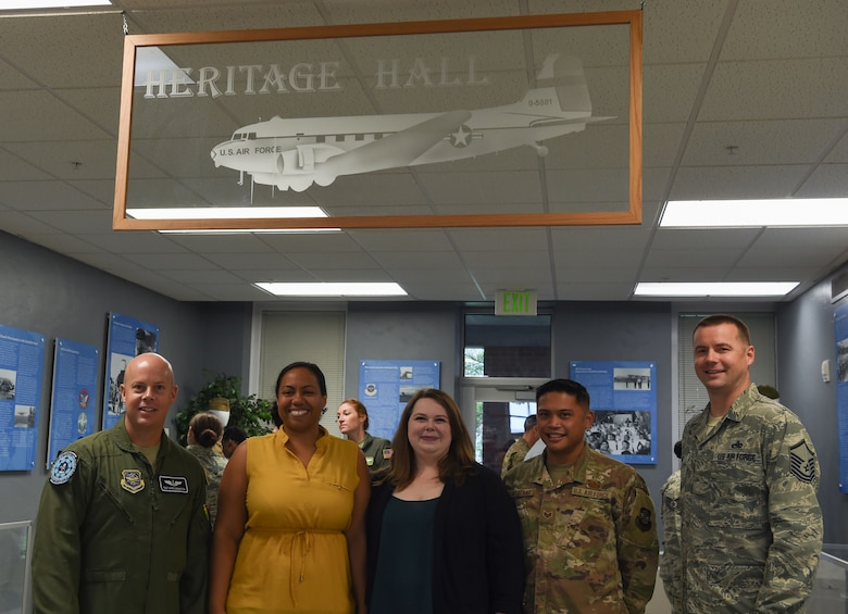 Erin Lasley, middle, 62nd Airlift Wing historian, and her team pose for a photo after a ribbon cutting ceremony opening the new Heritage Hall in the wing headquarters building at Joint Base Lewis-McChord, Wash., Oct. 21, 2019. Lasley and her team updated the hall to showcase Team McChord's heritage. (U.S. Air Force photo by Senior Airman Tryphena Mayhugh)