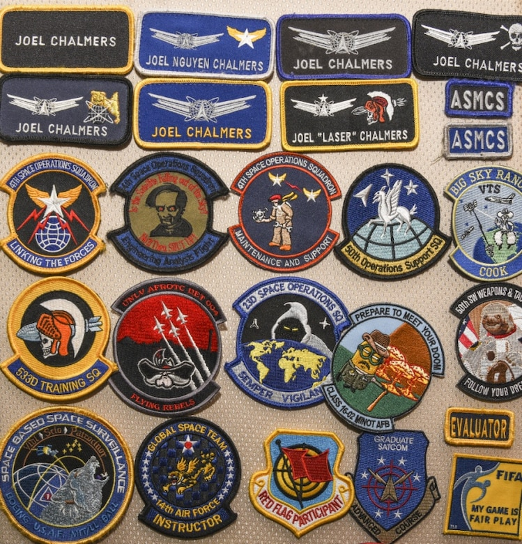 Patches owned by Major Joel N. Chalmers, 36th Wing Inspector General director of investigations, are displayed on Andersen Air Force Base, Guam, Oct. 2, 2019.