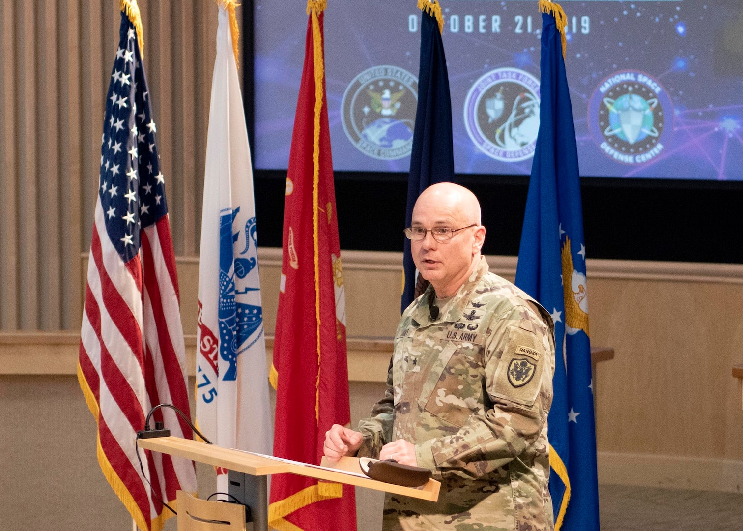 U.S. Army BG Thomas James delivers remarks to recognize the establishment of Joint Task Force Space Defense during a ceremony held at Schriever Air Force Base, Colo., Oct. 21, 2019. Joint Task Force Space Defense is one of two subordinate commands to USSPACECOM with a mission to conduct space superiority operations. (DoD photo by Patrick Morrow)