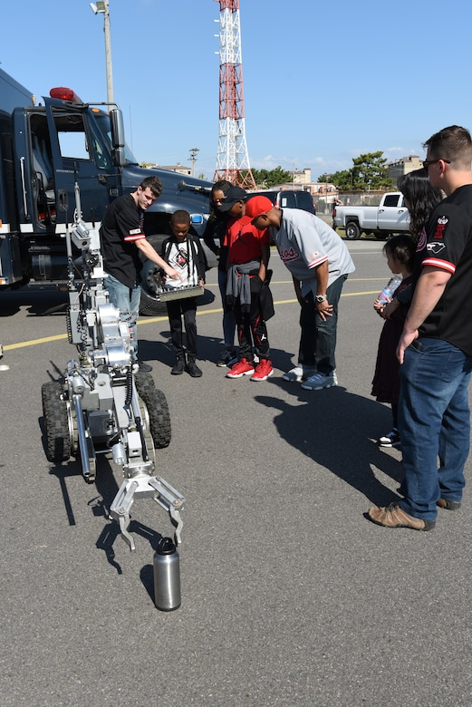 Victor Simmons controls a robot during the 2019 Penn Fest at Kunsan Air Base, Republic of Korea, Oct. 19, 2019. The 8th Civil Engineer Squadron Explosive Ordnance Disposal unit featured robots to show their use and give a better understanding of their job. (U.S. Air Force photo by Staff Sgt. Joshua Edwards)