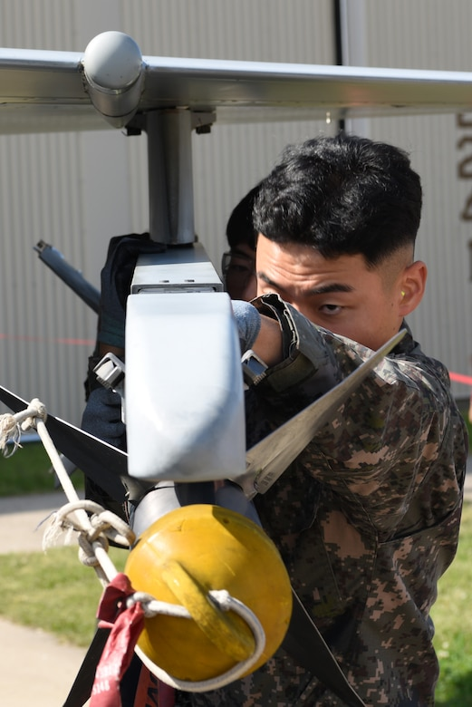 Members of the Republic of Korea air force's 38th Fighter Group Aircraft Maintenance Unit load a missile onto a KF-16 Fighting Falcon aircraft during the 2019 Penn Fest competition at Kunsan Air Base, Republic of Korea, Oct. 19, 2019. The 38th FG AMU competed against four U.S. Air Force teams and completed their loads with the second quickest times. (U.S. Air Force photo by Staff Sgt. Joshua Edwards)