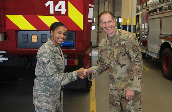 U.S. Air Force Col. Matthew S. Husemann, 86th Airlift Wing vice commander, poses for a photo with Airman 1st Class Kayla T. Jerido, 86th Civil Engineer Squadron fire protection journeyman, to recognize her as the Airlifter of the Week at Ramstein Air Base, Germany, Oct. 18, 2019. Jerido received the award after displaying strong leadership in several different roles within the fire-station. Perhaps most notably was Jerido's ability to lead a fire station immersion tour for the 20 NATO partner firefighters from Lithuania Romania and Ukraine. (U.S. Air Force photo by Senior Airman Kristof J. Rixmann)