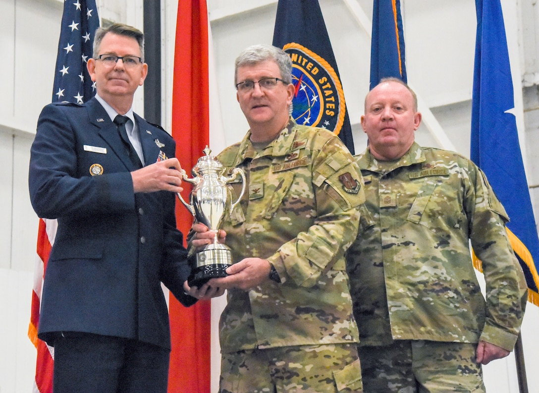 """Brig. Gen. James R. Stevenson, Jr., Mobilization Assistant to the Director of Operations United States Strategic Command, presents Col. Robert """"Scott"""" Grant, commander, 117 Air Refueling Wing, with the Omaha Trophy at Sumpter Smith Air National Guard Base, AL., Oct. 19, 2019.  The 117 ARW was the first Air National Guard tanker unit to receive the award having won it in the strategic aircraft category.  (U.S. Air National Guard photo by Master Sgt. Jeremy Farson)"""