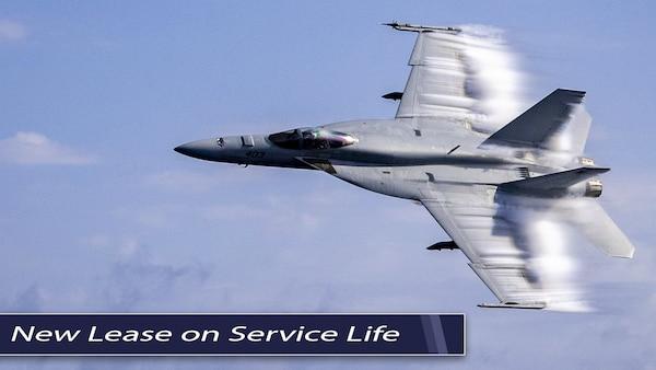 An F/A-18 Super Hornet flies through a blue sky. Text on photo: New Lease on Service Life