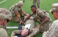 U.S. Army Soldiers roll a simulated casualty onto a litter during the culminating exercise for a Combat Lifesaver Course hosted by combat medics, with 38th Infantry Division, Task Force Spartan, Indiana National Guard, at Joint Training Center-Jordan Oct. 16, 2019.
