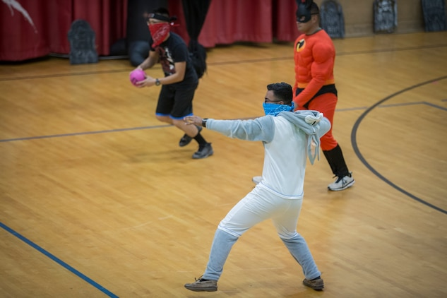 "U.S. Marines with Marine Corps Air Station (MCAS) Yuma, compete in the annual ""Dodge of the Dead"" dodgeball tournament at the gymnasium aboard MCAS Yuma, Ariz., Oct. 15, 2019. The Single Marine Marine Program sponsored event pitted teams of 6 costume clad service members against each other in a fierce competition. (U.S. Marine Corps photo by Lance Cpl John Hall)"