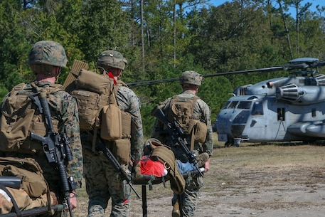 U.S. Marines and Sailors with the 26th Marine Expeditionary Unit (MEU) provide aid to simulated casualties during Composite Training Unit Exercise (COMPTUEX) in the vicinity of Camp Lejeune, North Carolina, Oct. 18, 2019. Bataan is underway conducting a COMPTUEX with the Bataan Amphibious Ready Group and 26th MEU. (U.S. Marine Corps photo by Lance Cpl. Gary Jayne III)