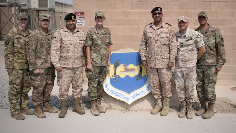 Kuwaiti army doctors and Colonels' Nawaf Jandoul Al-Dousari, right, and Raed R. Altajalli, left, view a specimen of a scorpion during a stop at the public health section of the 386th Expeditionary Medical Group clinic while visiting Ali Al Salem Air Base, Kuwait, Oct. 16, 2019. Al-Dousari and Altajalli, director and assistant director of the North Military Medical Complex respectively, visited the 386th EMDG clinic to tour the facility, share ideas on improving medical care and discuss strengthening interoperability. (U.S. Air Force photo by Tech. Sgt. Daniel Martinez)