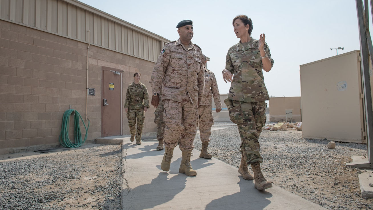 U.S. Air Force Col. Courtney Finkbeiner, right, 386th Expeditionary Medical Group commander, talks with Kuwait army Col. Nawaf Jandoul Al-Dousari, North Military Medical Complex director, while taking a tour of the 386th EMDG base clinic at Ali Al Salem Air Base, Kuwait, Oct. 16, 2019. The Kuwait army directors of the North Military Medical Complex visited the 386th EMDG clinic to tour the facility, share ideas on improving medical care and discuss strengthening interoperability. (U.S. Air Force photo by Tech. Sgt. Daniel Martinez)