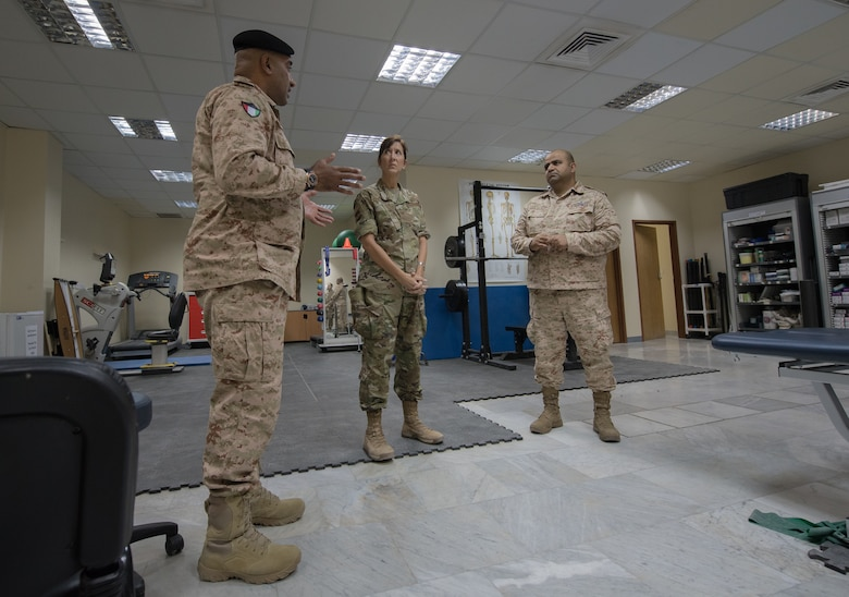 Kuwaiti army doctors and Colonels' Nawaf Jandoul Al-Dousari, left, and Raed R. Altajalli, right, have a discussion with Col. Courtney Finkbeiner, 386th Expeditionary Medical Group commander, while viewing the physical therapy rehabilitation room at the base clinic at Ali Al Salem Air Base, Kuwait, Oct. 16, 2019. Al-Dousari and Altajalli, director and assistant director of the North Military Medical Complex respectively, visited the 386th EMDG clinic to tour the facility, share ideas on improving medical care and discuss strengthening interoperability.  (U.S. Air Force photo by Tech. Sgt. Daniel Martinez)