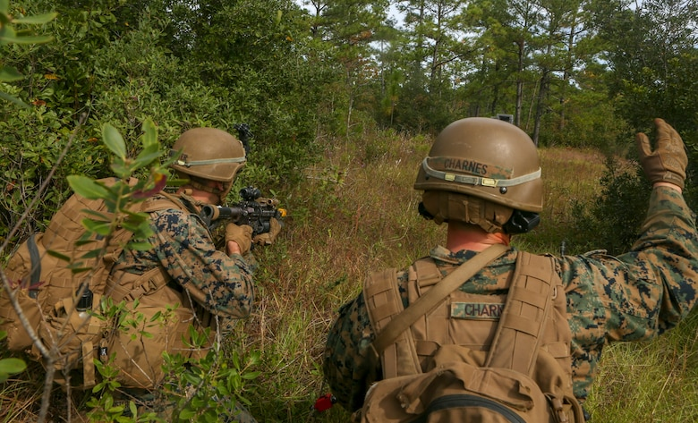 U.S. Marines with Weapons Company, Battalion Landing Team, 2nd Battalion, 8th Marine Regiment, 26th Marine Expeditionary Unit (MEU), provide security during a Tactical Recovery of Aircraft and Personnel mission as part of Composite Training Unit Exercise (COMPTUEX) in the vicinity of Camp Lejeune, North Carolina, Oct. 19, 2019. Bataan is underway conducting a COMPTUEX with the Bataan Amphibious Ready Group and 26th MEU. (U.S. Marine Corps photo by Lance Cpl. Gary Jayne III)