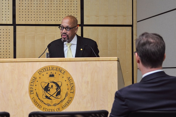 Claiborne Haughton speaks during a National Disability Employment Awareness Month event at the Defense Intelligence Agency Headquarters, Oct.10. During his government career, Haughton led several efforts to promote and protect the employment of persons with disabilities.
