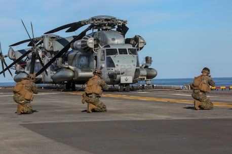 U.S. Marines with Fox Company, Battalion Landing Team, 2nd Battalion, 8th Marine Regiment, 26th Marine Expeditionary Unit (MEU), conduct fire team drills on the flight deck of the amphibious assault ship USS Bataan (LHD 5) during Composite Training Unit Exercise (COMPTUEX) in the Atlantic Ocean Oct. 12, 2019. Bataan is underway conducting a COMPTUEX with the Bataan Amphibious Ready Group and 26th MEU. (U.S. Marine Corps photo by Lance Cpl. Gary Jayne III)