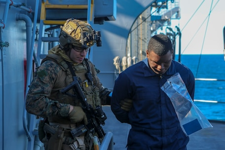 U.S. Marines with the Maritime Raid Force, 26th Marine Expeditionary Unit (MEU), conduct a Visit, Board, Search and Seizure mission during Composite Training Unit Exercise (COMPTUEX) in the Atlantic Ocean Oct. 17, 2019. Bataan is underway conducting a COMPTUEX with the Bataan Amphibious Ready Group and 26th MEU. (U.S. Marine Corps photo by Lance Cpl. Gary Jayne III)