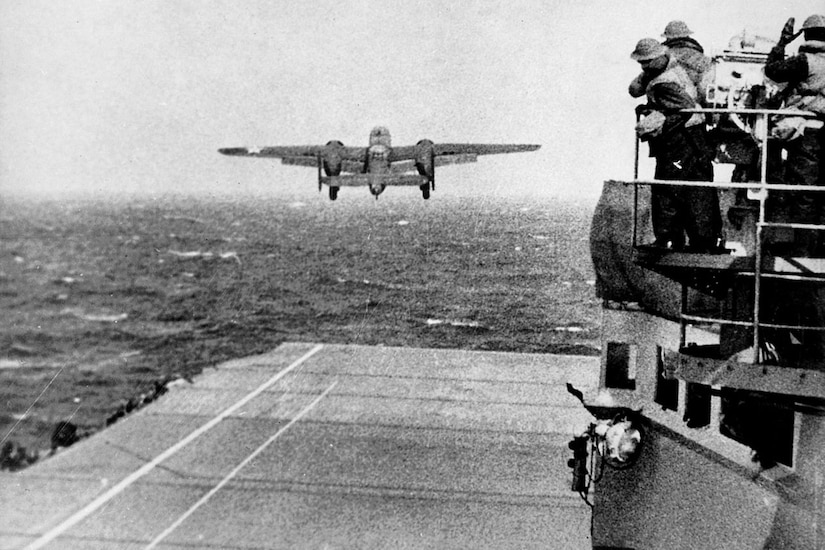 A plane takes off from the flight deck of a carrier.
