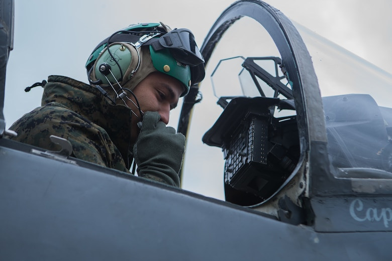 Marine Sgt. Cesar Garcia performs preventative maintenance on an AV-8B Harrier II during exercise Banzai Badlands in Sioux Falls, S.D., Oct. 11, 2019. Marine Attack Squadron 231 and the 114th Fighter Wing of the South Dakota Air National Guard participated in a three-day exercise consisting of simulated air-to-air combat and air-to-ground strikes. Garcia is an avionic technician with VMA-231, Marine Aircraft Group 14, 2nd Marine Aircraft Wing. (U.S. Marine Corps photo by Lance Cpl. Gavin Umboh)