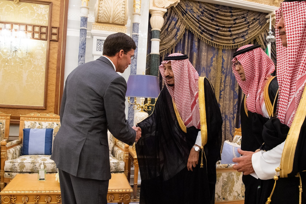 Defense Secretary Mark T. Esper shakes hands with Saudi Arabia's king.