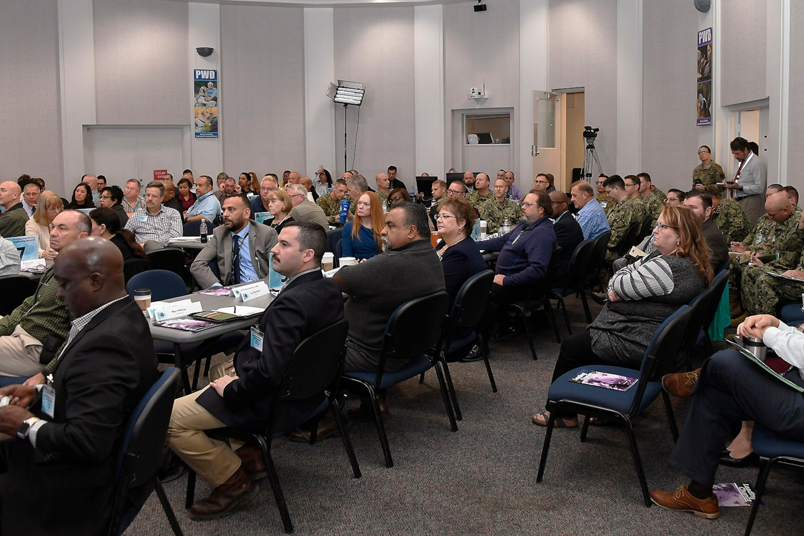 Senior staff members, regional directors, area managers and Disposal Support Unit leaders listen during the address.