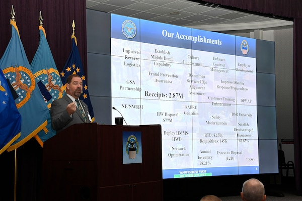 DLA Disposition Services Director Mike Cannon reviews accomplishments for the past year with the summit attendees.