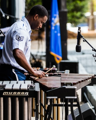 "Staff Sergeant Quincy Brown performs an arrangement of Vittorio Monti's ""Czardas"" as a soloist with the concert band on xylophone, marimba, and vibraphone in his short sleeved blue uniform during a spring 2019 tour of the southeastern United States."