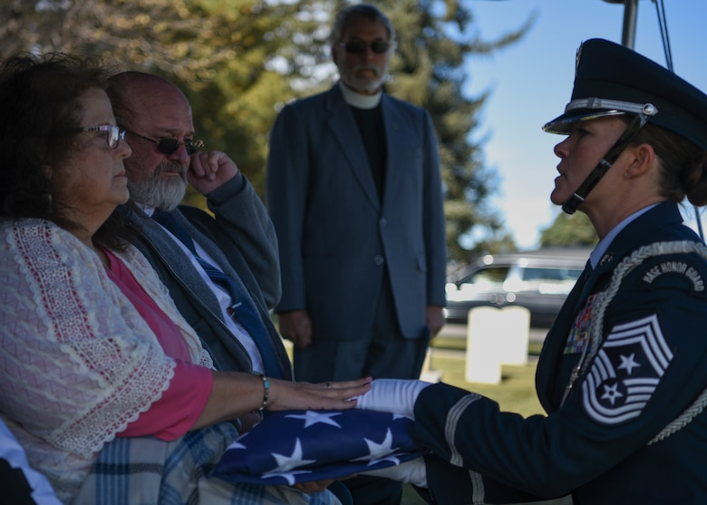 Chief Master Sgt. Tiffany Bettisworth, 90th Missile Wing command chief, presents the American flag to retired Master Sgt. Robert Meadows next-of-kin, on Oct. 22, 2019, on F.E. Warren Air Force Base, Wyo. While serving, Meadows provided critical, high precision geospatial and geophysical information for defense and intelligence needs around the world. (U.S. Air Force photo by Senior Airman Nicole Reed)