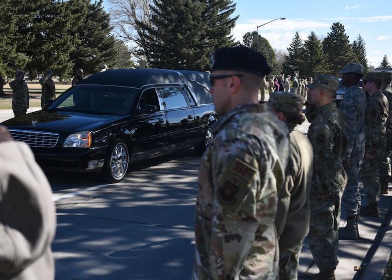 Airmen and staff members give retired Master Sgt. Robert Meadows a final salute as he enters the base for the last time on Oct. 22, 2019, on F.E. Warren Air Force Base, Wyo. Meadows served 20 years in the Air Force, retiring from the 1381st Geodetic Survey Squadron in 1966.(U.S. Air Force photo by Staff Sgt. Ashley N. Sokolov)