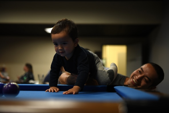 Capt. Joseph Matejcik, (right) 10th Space Warning Squadron civil engineer officer, plays with his son Sept. 26, 2019 at Cavalier Air Force Station, North Dakota. The community center is the main building on the installation for parents to come together and play with their kids. (U.S Air Force photo by Master Sgt. Sara Keller)