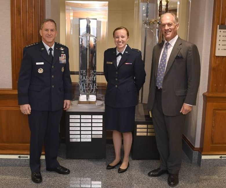 Air Force Chief of Staff Gen. David L. Goldfein (left) posed for a photo with 2019 Cadet of the Year, 2nd Lt. Kirsten Cullinan, and Jonathan Elwes of the Royal Air Squadron Oct. 22, 2019, at the Pentagon, Arlington, Va. (Air Force photo by Andy Morataya)