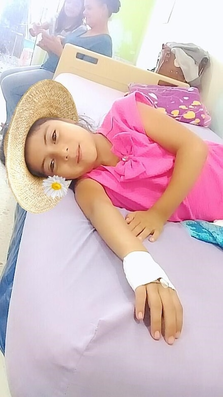 Yenci, a young girl whose arm deformity was identified by Civil Affairs Team