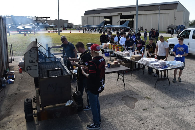 The 8th Maintenance Group provides free food during the 2019 Penn Fest at Kunsan Air Base, Republic of Korea, Oct. 19, 2019. The 8th MXG invited the ROK air force and Osan Air Base partners to compete in a load crew competition. (U.S. Air Force photo by Staff Sgt. Joshua Edwards)