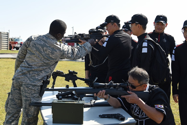 U.S. Air Force Senior Airman Josue Enalien, 8th Security Forces defender, shows members of the Republic of Korea Air Force's 38th Fighter Group different types of weapons used in base defense operations at the 2019 Penn Fest at Kunsan Air Base, ROK, Oct. 19, 2019. Security forces, explosive ordnance disposal and firefighters provided displays and demonstrations for the audience. (U.S. Air Force photo by Staff Sgt. Joshua Edwards)