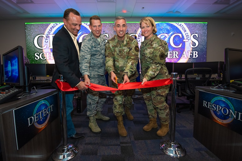From left, retired Col. Jason Sutton, former 50th Network Operations Group commander; Col. James Smith, 50th Space Wing commander; Maj. Gen. Stephen Whiting, 14th Air Force commander; and Brig. Gen. Deanna Burt, Air Force Space Command director of operations and communications, cut a ribbon signifying the standup of the Cyber Defense Correlation Cell for Space at Schriever Air Force Base, Colorado, Oct. 18, 2019. The CDCC-S is the first of its kind in the Air Force and will detect and respond to cyber threats against AFSPC mission systems. (U.S. Air Force photo by Kathryn Calvert)