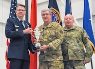 "Brig. Gen. James R. Stevenson, Jr., Mobilization Assistant to the Director of Operations United States Strategic Command, presents Col. Robert ""Scott"" Grant, commander, 117 Air Refueling Wing, with the Omaha Trophy at Sumpter Smith Air National Guard Base, AL., Oct. 19, 2019.  The 117 ARW was the first Air National Guard tanker unit to receive the award having won it in the strategic aircraft category.  (U.S. Air National Guard photo by Master Sgt. Jeremy Farson)"