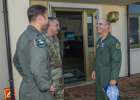 U.S. Air Force Gen. Jeff L. Harrigian, right, U.S. Air Forces in Europe and Air Forces Africa commander, speaks with Chief Master Sgt. Matthew Pipes, middle, 31st Aircraft Maintenance Squadron, 555th Aircraft Maintenance Unit superintendent and Lt. Col. Beau E. Diers, 555th Fighter Squadron commander, at Aviano Air Base, Italy, Oct. 22, 2019.
