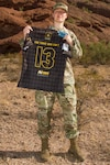 U.S. Army Spc. Samantha Coleman, a motor transport operator with the 2220th Transportation Company in Tucson, Ariz., poses with her All-Army Women's Rugby Team jersey at Papago Park Military Reserve Oct. 20, 2019. Coleman says she has found a deep sense of family and belonging in both the Army and her rugby team.