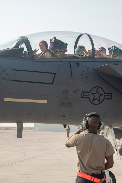 Lt. Col. Jaina Donberg, 494th Fighter Squadron commander, signals to a crew chief from the 380th Expeditionary Aircraft Maintenance Squadron, after parking Oct. 21, 2019, at Al Dhafra Air Base, United Arab Emirates.