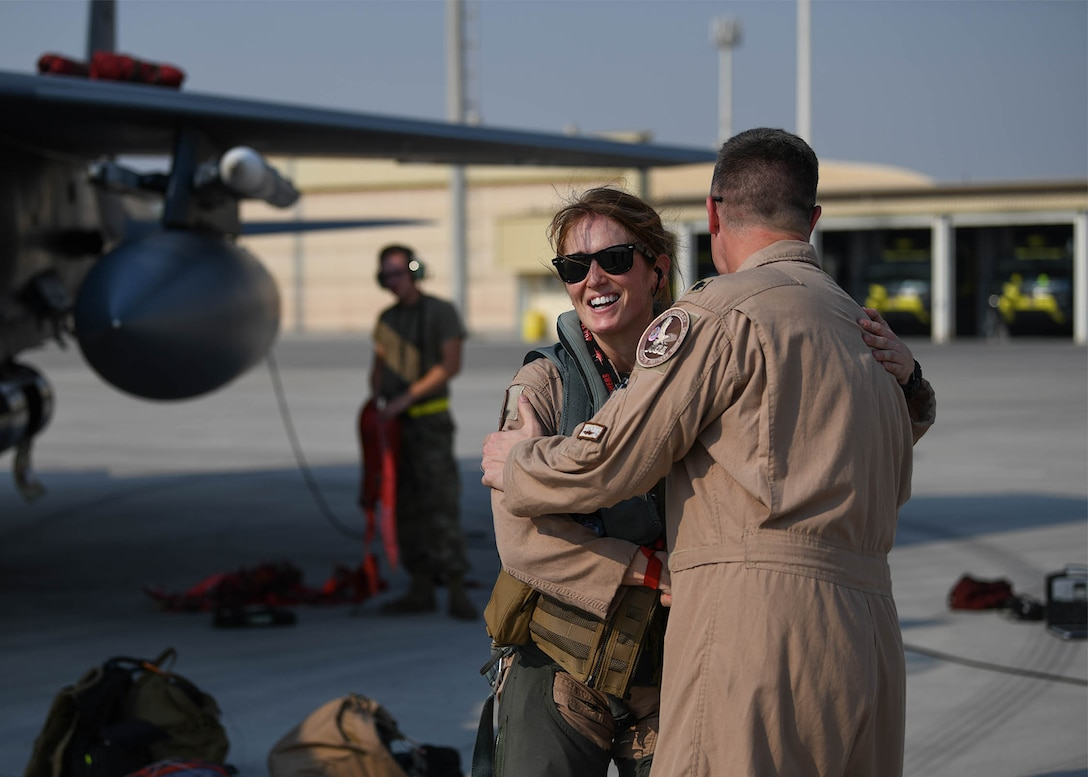 Lt. Col. Jaina Donberg, 494th Fighter Squadron commander, greets Lt. Col. Ryan Lippert, 494th FS assistant director of operations, Oct. 21, 2019, after arriving at Al Dhafra Air Base, United Arab Emirates.