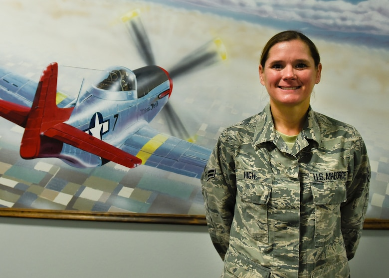 Airman 1st Class Dana High, 363rd Training Squadron maintenance management production apprentice course graduate, poses for a photo at Sheppard Air Force Base, Texas, Oct. 23, 2019. High was awarded the ACE award after receiving 100 percent scores on all six block tests in 33 days of instruction at Sheppard. (U.S. Air Force photo by Airman 1st Class Pedro Tenorio)