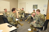 Soldiers from the South Dakota Army National Guard go through a role playing exercise during the Traumatic Event Management course at Camp Rapid in Rapid City, S.D., Oct. 10, 2019. The TEM course helped to develop the organization's response and support services throughout the state.